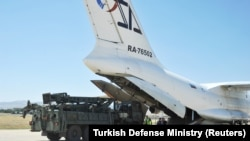 Parts of a Russian S-400 defense system are unloaded from a Russian plane at Murted Airport near Ankara in August.