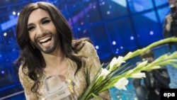 "Conchita Wurst has said she would ""love to spend at least a week"" with Russian President Putin in order to grasp what it means to ""be President Putin."""