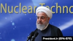 "Iranian President Hassan Rohani delivers a speech during a ""nuclear technology day"" in Tehran on April 9."