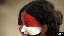 محتجة مصرية في ميدان التحرير بالقاهرة