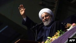 Iranian President Hassan Rohani greets supporters during a campaign rally in Hamedan on May 8.