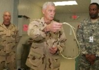 A doctor at Guantanamo explains force-feeding to journalists in February 2006 (epa)