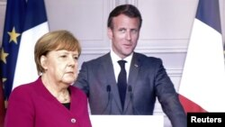 German Chancellor Angela Merkel (left) and French President Emmanuel Macron (file photo)
