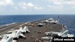 ناو هواپیمابر استنیز آمریکا که آمریکا می گوید برای حفاظت از متحدان خود در منطقه مستقر کرده است