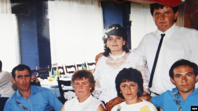 The gunman, Ljubisa Bogdanovic, appears (far left) in a picture provided by a resident of Velika Ivanca, where the tragedy took place on April 10.