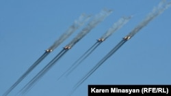 Armenia - Armenian Su-25 warplanes fire rockets during CSTO military exercises near Yerevan, 16Sep2012.