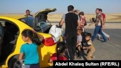 Жителі Мосула тікають зі свого міста після нападу бойовиків, Ірак, 10 червня 2014 року