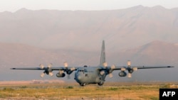 The C-130 Hercules transport plane is used extensively by the military to ship troops as well as heavy equipment and it is designed for taking off and landing on rough terrain. (file photo)