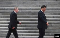 Си Цзиньпин и Владимир Путин в Пекине 25 июня