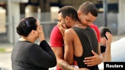 Шок и скорбь среди родных и близких тех, кто погиб при стрельбе. Орландо, 12 июня 2016