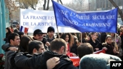Armenians rally outside the French Embassy in Yerevan to thank France for a bill passed by its Senate making denial of the Armenian genocide a crime on January 24.