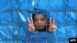Маленький сирийский беженец в лагере для беженцев на турецкой территоии. Йайладаги, 26 марта 2012 года.