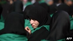 Iraq - A Shiite Muslim woman attends the Arbaeen religious festival in the shrine city of Karbala, 03Jan2013