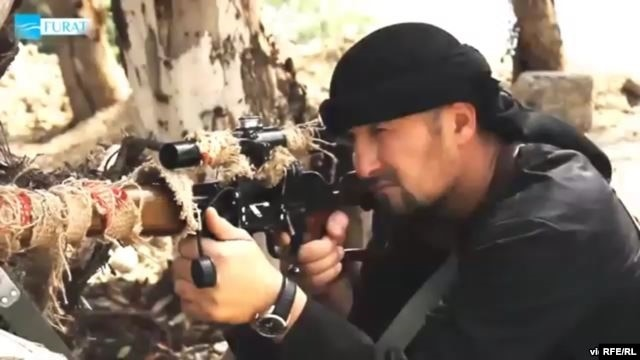 Former Tajik police commander Gulmuro Halimov appeared in a video posted online that showed him brandishing a sniper rifle and threatening to bring holy war to Russia and the United States.