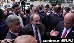 Prime Minister Nikol Pashinian visits protesters outside a court in Yerevan on May 20.