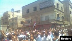 Demonstrators march through the streets of Damascus on July 1.