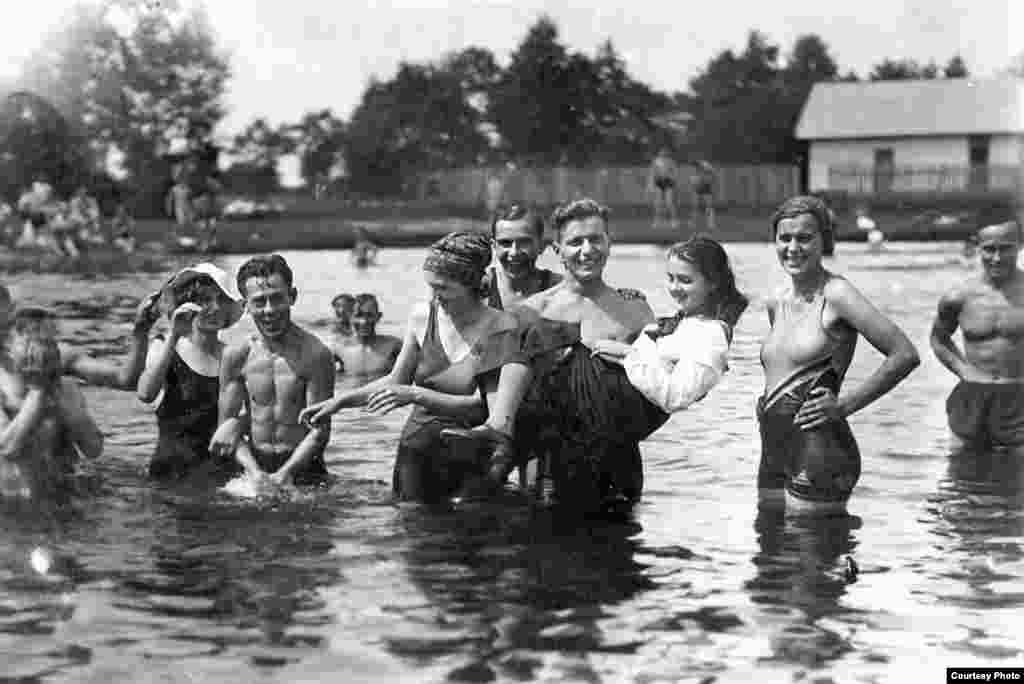 Many pictures are haunting for the juxtaposition of joyous images against the grim knowledge of what was to come. Areta Kovalsky, a Ukrainian-American living in Lviv, grew up listening to stories from her grandmother Bohdana, about Bohdana's younger sister, Maria (pictured here in 1936, being held above the water). The two were separated during World War II -- Bohdana fled for the United States, while Maria, a member of the Ukrainian Insurgent Army, was trapped in a city under heavy bombardment. Maria was later arrested for partisan activities and spent 15 years in prison. It would be 50 years before the sisters would see each other again.