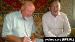 Viktar Statkevich (right) and human rights advocate Syarhey Housha in Baranavichy on September 9