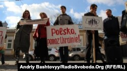 "Protesters outside the Polish Embassy in Kyiv on October 31 decried what they said was a ""homodictatorship."""