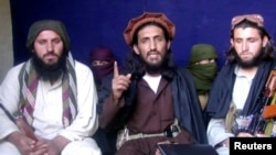 Omar Khalid Khorasani, center, a top Pakistan Taliban commander, gives an interview in Pakistan's Mohmand tribal region in 2011.