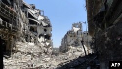 A handout picture released by the Syrian opposition's Shaam News Network on July 27, 2012 shows destruction in the Juret al-Shayah district of the central city of Homs.