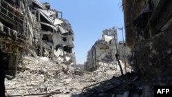 Хомс қаласындағы қираған үйлер. Сирия, 27 шілде 2012 жыл.