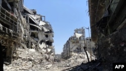 A handout picture released by the Syrian opposition's Shaam News Network on July 27 shows destruction in the Juret al-Shayah district of the central city of Homs.