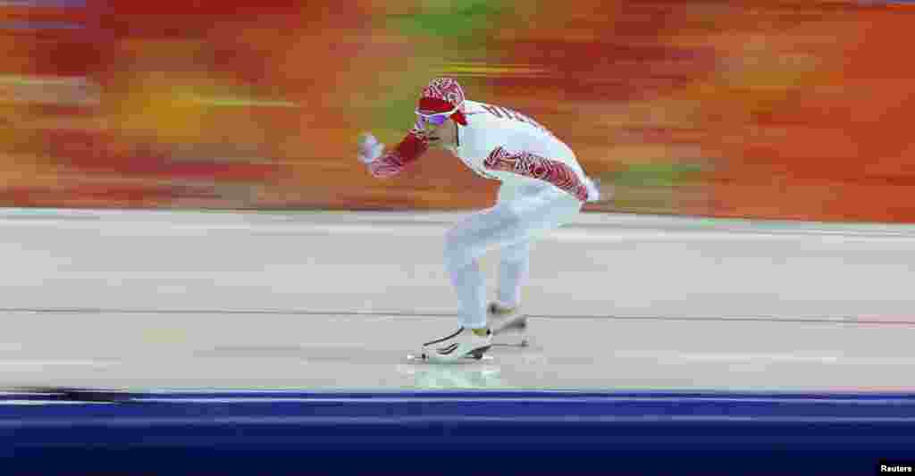 Aleksandr Rumyanstsev of Russia competes in the men's 5,000 meters speed skating race.