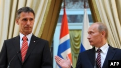 Russian President Vladimir Putin (right) with the next NATO Secetary-General Jens Stoltenberg (file photo)