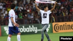 Armenia - Opposition activist Shahen Harutiunian invades the pitch during an Armenia-Portugal football game at the Republican Stadium in Yerevan, 13Jun2015.