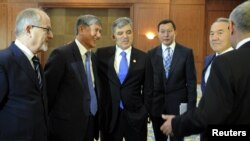 Turkish President Abdullah Gul (third from left) with other participants in a summit of Turkic-speaking countries outside Bishkek on August 23, before his sudden departure.