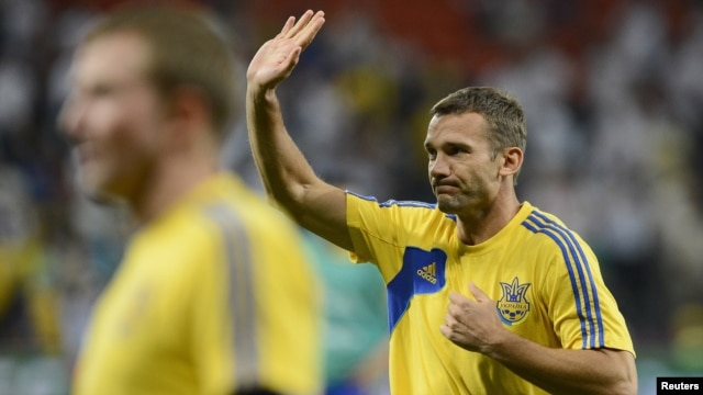 Andriy Shevchenko waves before the start of his team's Euro 2012 soccer match against England at Donbass Arena in Donetsk on June 19.