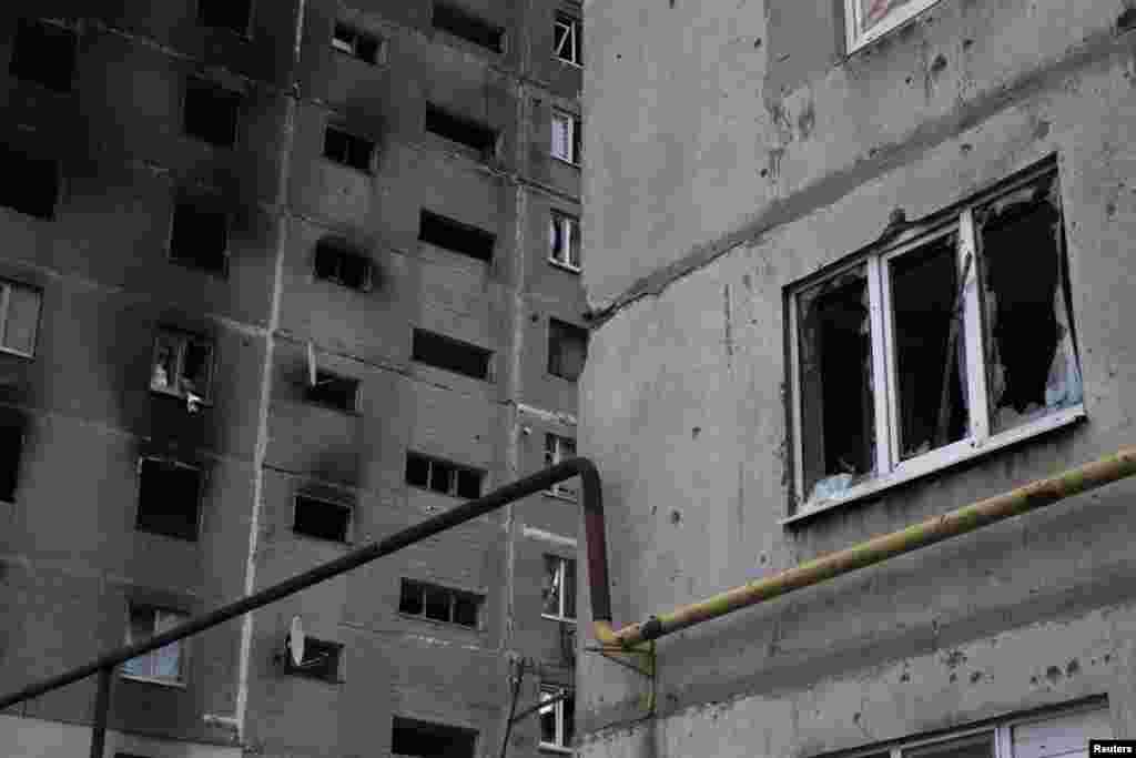 Зруйнований внаслідок бойових дій будинок, Ясинувата, Донецька область 22 вересня 2014 року
