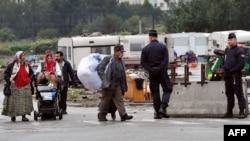 Поліція слідкує за евакуацією найбільшого ромського табору поблизу міста Ліля, 18 вересня 2013 року