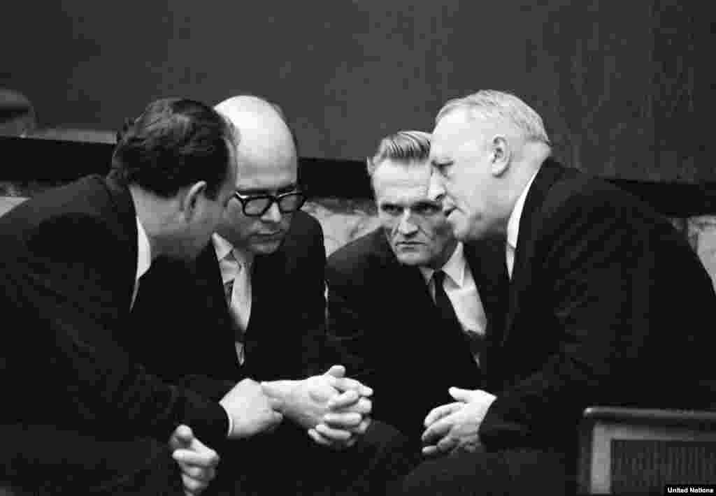 "Mario Garcia-Inchaustegui, Cuba's ambassador to the UN, seen here (second from left) conferring with Soviet Ambassador Valerian Zorin (right), seeks a Security Council debate on the blockade, which he calls an ""act of war unilaterally committed"" by the U.S."