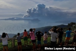 Filipinos watch the Taal eruption from the relative safety of Tagaytay City, about six kilometers from Taal's caldera, on January 13