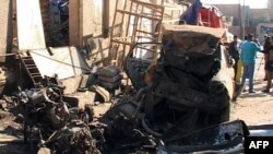 Pamje në Hilla ku nga sulmet me bomba janë vrarë së paku 27 vetë