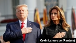 U.S. President Donald Trump and first lady Melania Trump observe a moment of silence to mark the 18th anniversary of September 11 attacks on the South Lawn of the White House in Washington, September 11, 2019