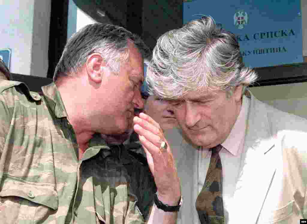 Bosnian Serb Commander Ratko Mladic speaks to Bosnian Serb leader Radovan Karadzic during a meeting in Pale, Bosnia and Herzegovina, on August 5, 1993.  Both men are currently in custody and on trial for war crimes at the International Criminal Tribunal in The Hague.
