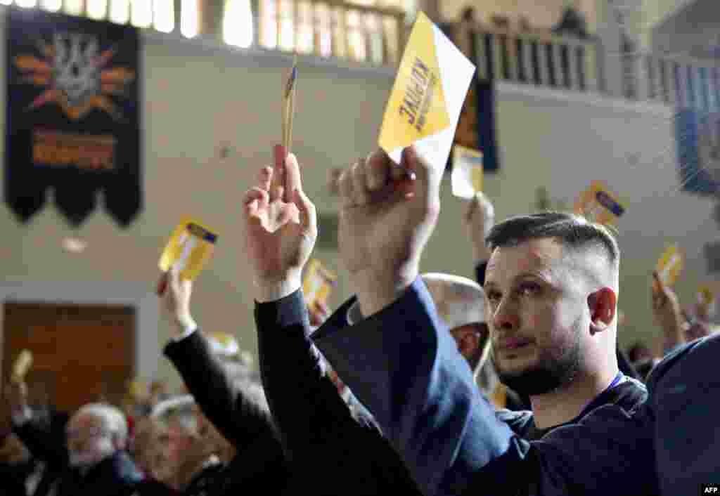 Members of Ukraine's far-right Azov battalion move to officially create a political party in Kyiv on October 14. (AFP/Genya Savilov)