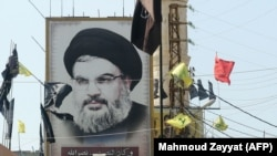 A portrait of the head of the Lebanese Shi'ite movement Hezbollah, Hassan Nasrallah, is seen in southern Lebanon,