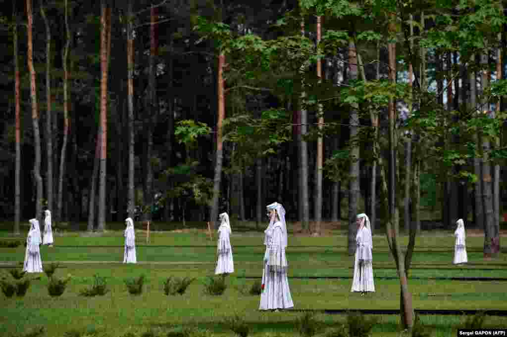 Actors perform during a ceremony to unveil a monument to the victims of World War II on the grounds of the former Nazi concentration camp in Trostenets outside Minsk, Belarus, on June 29. (AFP/Sergei Gapon)