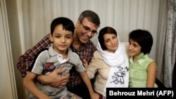 Nasrin Sotoudeh poses with her family at her house in Tehran in September 2013 after serving three years in prison.