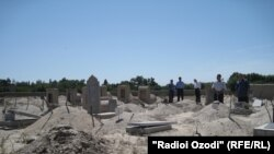 Tajikistan -- Cemetery in district of Bobojon Ghafurov, Sughd region, 24May2012