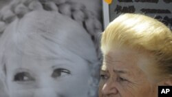 A Yulia Tymoshenko supporter at a rally at a tent camp outside the court in Kyiv on September 5