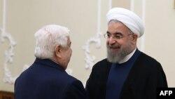 Хасан Роухани во время встречи с министром иностранных дел Сирии Валидом аль-Муаллемом в Тегеране, 5 августа 2015 года.