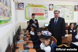 Tajik President Emomali Rahmon visits a school in the Rudaki district last year.