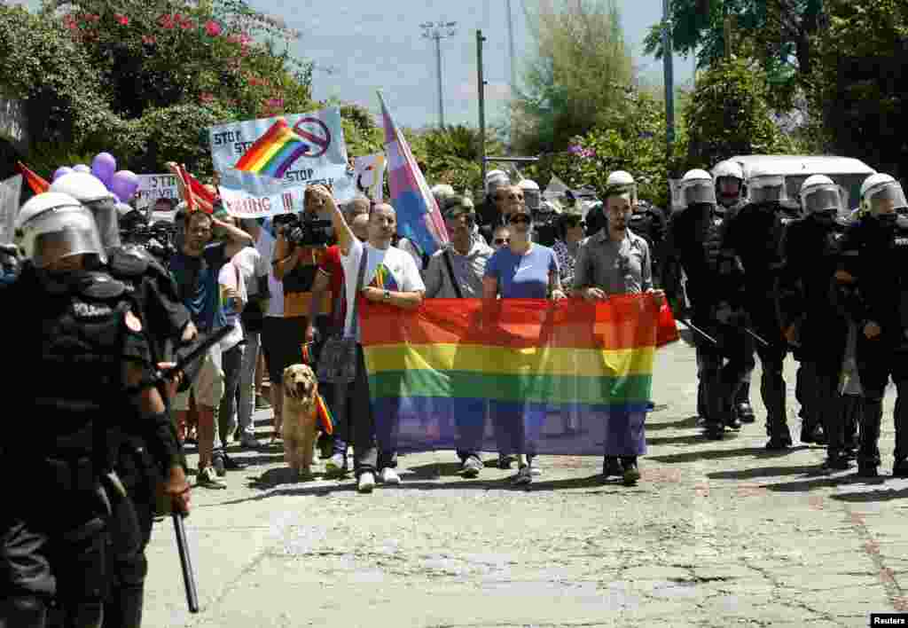 Montenegrin riot police accompany activists during a gay-pride parade in Budva on July 24.