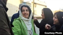 File photo: Iranian human rights activist, Narges Mohammadi (C), in front of Evin prison.