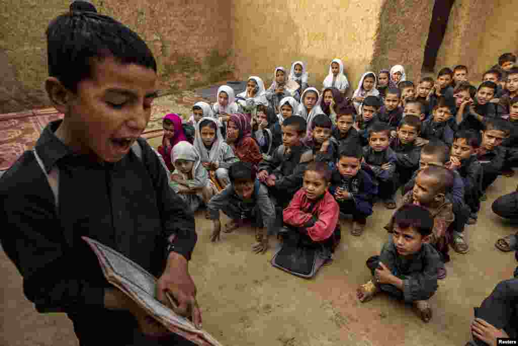 A Pakistani boy recites from a book during a lesson at a school in a slum on the outskirts of Islamabad. (Reuters/Zohra Bensemra)